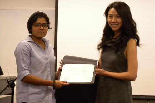 Neha Ravella receives the Rhetoric and Digital Design Award from Lai-Tze Fan