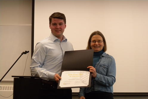 Christopher Cameron receives the Beltz Essay Prize, PhD from Alice Kuzniar.