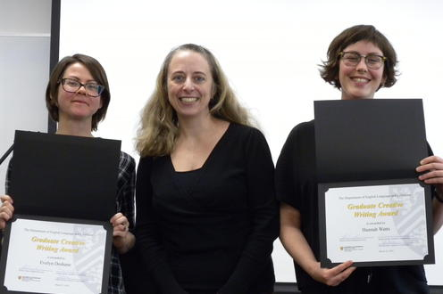 Hannah Watts and Evelyn Deshane receive the Graduate Creative Writing Award from Veronica Austen.