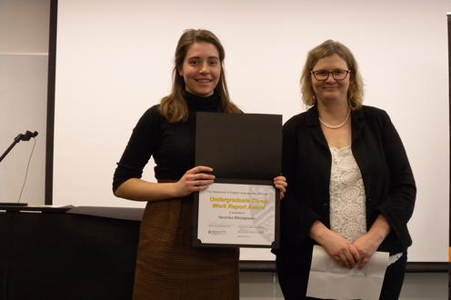 Veronika Mikolajewski receives the Undergraduate Co-op Work Report Award from Victoria Lamont
