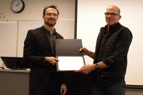 Andrew Myles receives the Graduate Co-op Work Report Award from Marcel O'Gorman