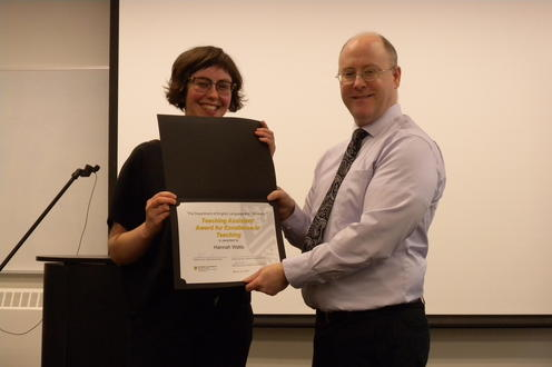 Hannah Watts receives the TA Award for Excellence in Teaching from George Lamont
