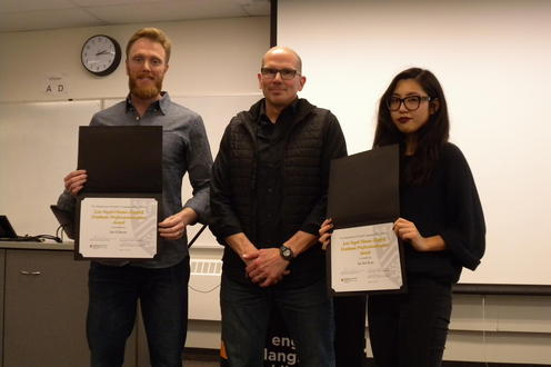 Ian Gibson and Jin Sol Kim receive the Lea Vogel-Nimmo Graduate Professionalization from Marcel O'Gorman