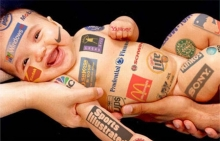 Baby covered in logos.