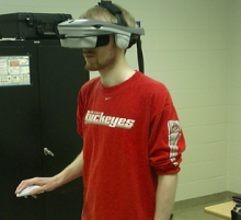 Person wearing virtual reality helmet.