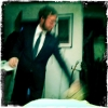 Blurry picture of Kent Aardse in a suit.