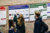 Photo of students looking at science posters.
