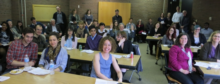 Photo of staff and students at tables at teaching orientation.