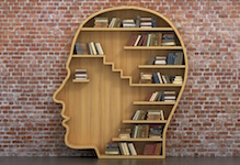 Photo of head-shaped bookshelf.