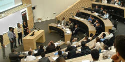 Photo of students giving a presentation in a lecture hall.