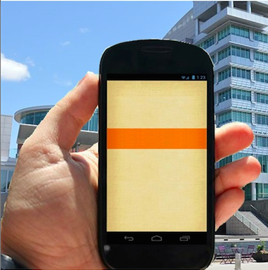Picture of hand holding a smart phone with a building in the background.