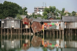 Slum houses on stilts amongst flooding in Dhaka India