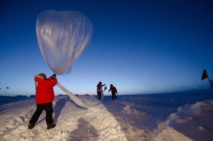 a man with a parka and a weather balloon