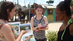 Planning students interview a local on the beach in Jamaica