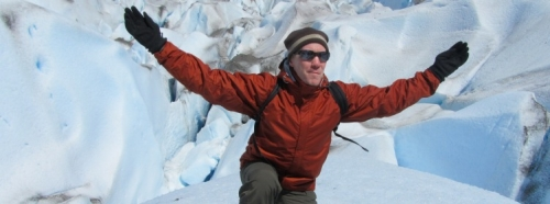 Devin Causley rejoicing on a glacier in the antarctic