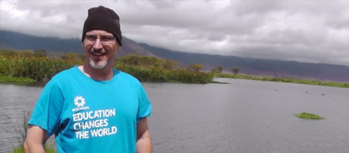 Larry Swatuk standing in front of river in Tanzania