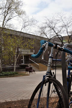 A bike leaning on a bike rack in front of Environment 1 (EV1) building.