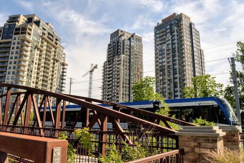 a bridge a train and some condo buildings