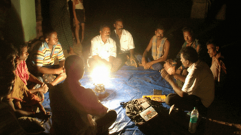 Indian villagers discussing around a campfire at night