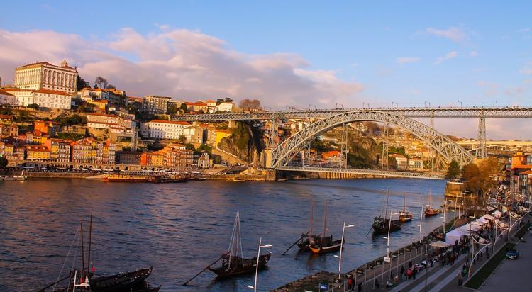 I took this photo from the balcony of a port winery in Porto, Portugal. It is a very charming town and many of the port houses on the opposite side of the river offer stunning views of the city at sunset.