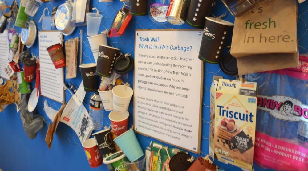 A display showing recyclables found in garbage bins around campus
