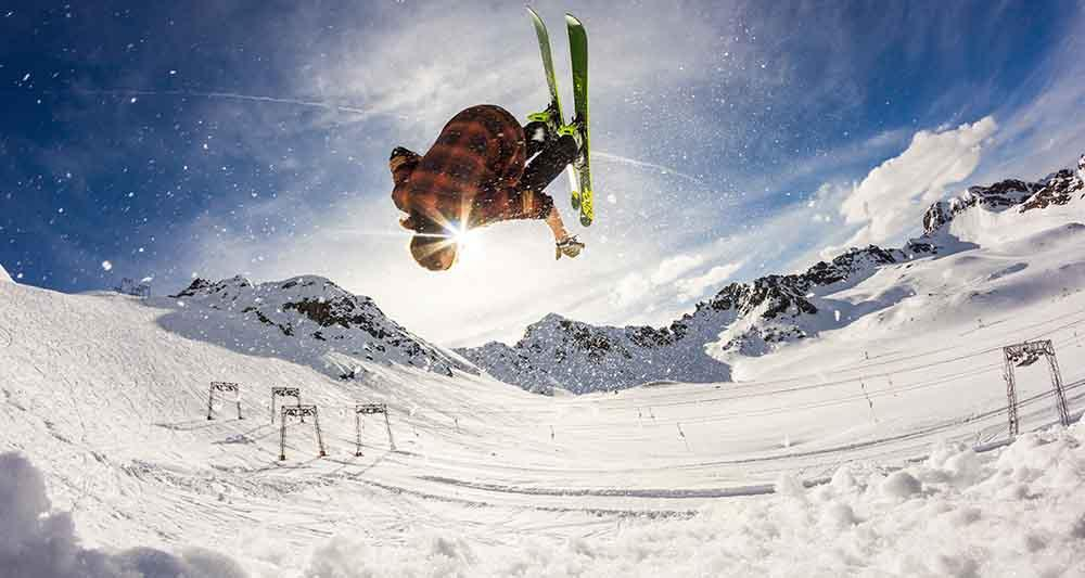 A skiier taking off from a jump