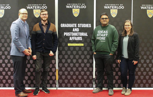 Environment students (Fraser King, Jaydeep Mistry, Stephanie Higgins) on red carpet with Jeff Casello, the associate VP of GSPA