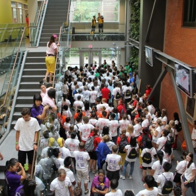 A large crowd of students fill the atrium.