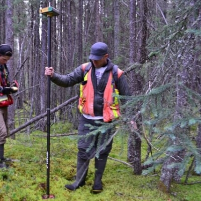 Two researchers working in the field