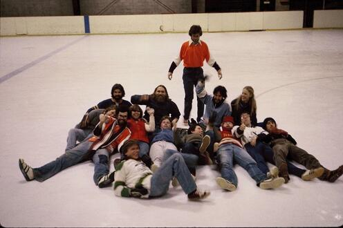 Classmates laying on the ice together after broomball