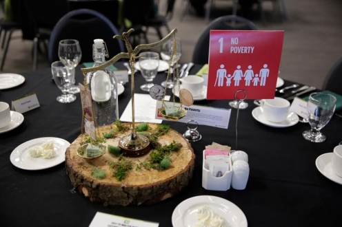 Wooden centre piece with symbols of the 17 Sustainable Development Goals