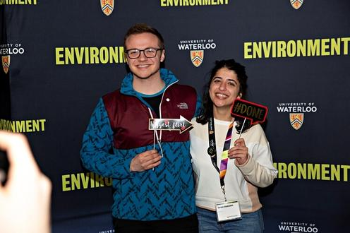 students posing in front of environment backdrop