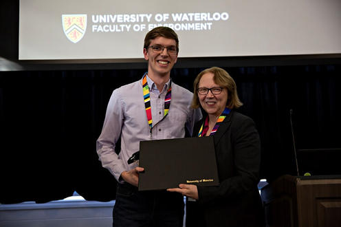 Dean Jean and a student awardee holding up a prize
