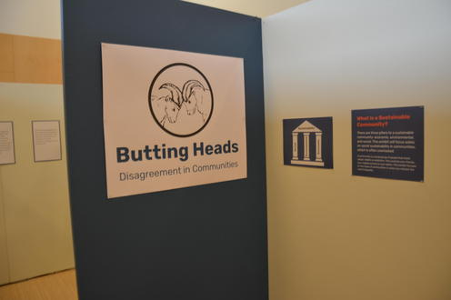 Butting Heads exhibit sign
