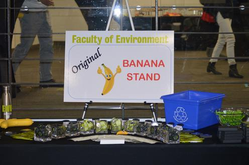 The orginial banana stand showcasing a table of faculty swag