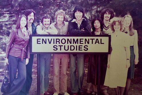 Classmates standing at the Environmental Studies sign.