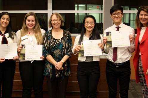 Four students and two professionals pose for picture with certificates