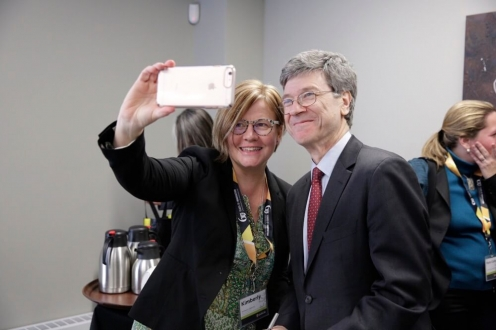 Blond woman taking selfie with man