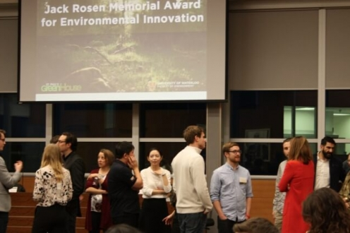 Students visit with judges before pitches get underway