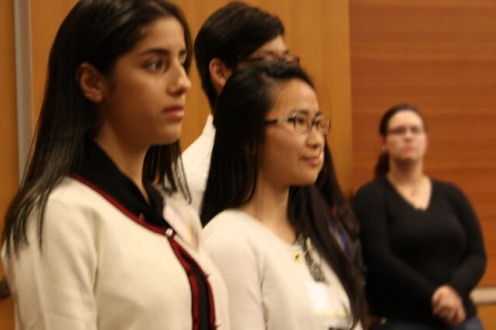 Line of three students waiting to pitch