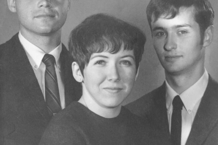 Black and white image of two young men and one women from 1968.