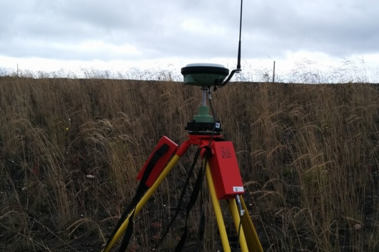 GPS unit on a tripod in the field