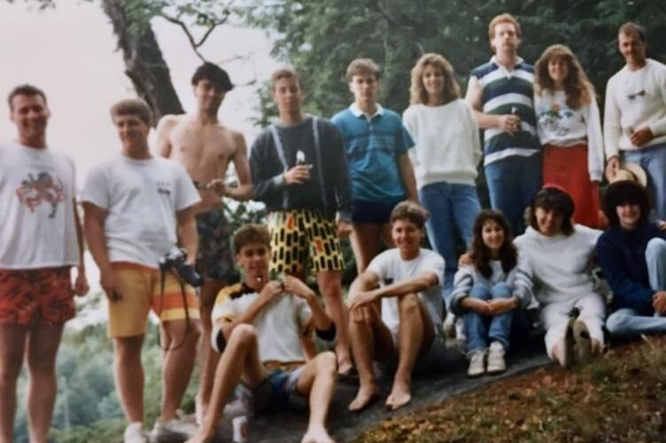 Student at a cottage gathered for group photo