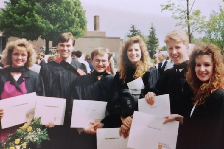 Student holding their diplomas