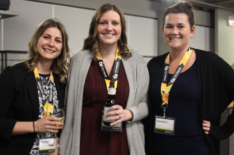 Three smiling female grad students