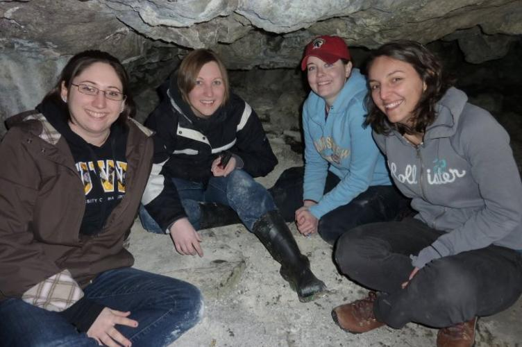 four girls in a cave