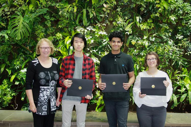 Dean Jean posing with the recipients and their certificates