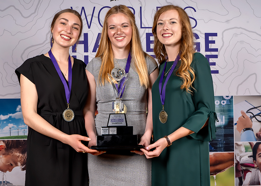 SheCycle holding Trophy at World's Challenge Challenge