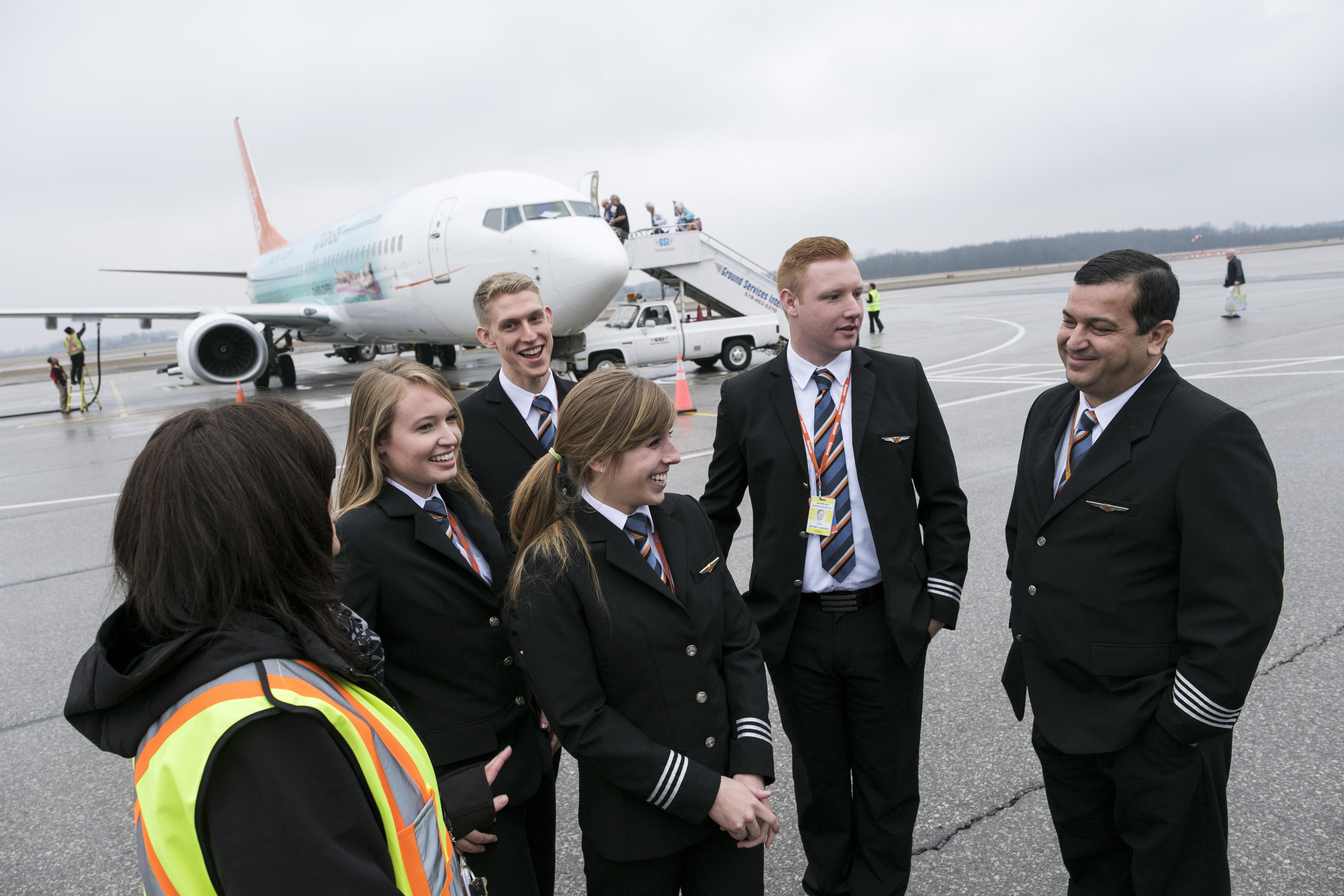Waterloo students with personal from Sunwing Airlines at the Waterloo-Wellington Flight Centre