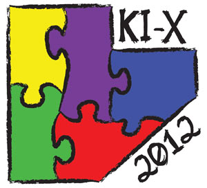 "Logo showing brightly coloured interconnected puzzle pieces and reading ""KI-X 2012."""